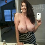 Naughty MILF is without bra naked selfie