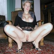 Busty Mature girl panties stripping on a armchair