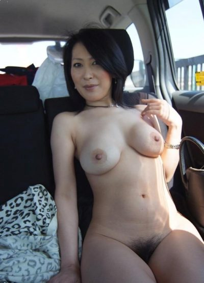 Amateur Asian MILF shows off her nipples and hairy pussy in the car. Hot oriental mature chick shows her natural boobs and hot pussy