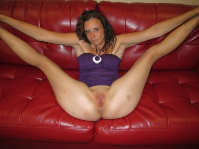 Nude amateur MILF first timer showcases her blad muff. Lusty wife removes her panties for nude posing on the red sofa