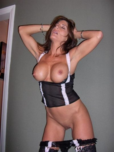 Beautiful MILF chick shows her big tits and sexy pussy by undressing fancy underwear. Milf babe with bald cunt and gorgeous tits shows off in high heels