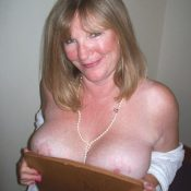 Busty blonde mature girl in erotic picture