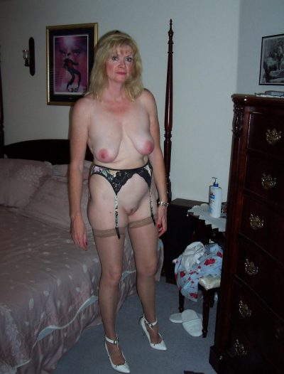 Older amateur mature blonde shows her natural hard nipples in her homemade striptease