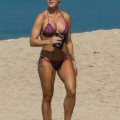 Muscle MILF walking non nude in bikini on the beach