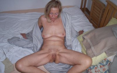Amateur mature babe revealing small boobs and old cunt. Sexy mature lady strips naked before spreading her beaver