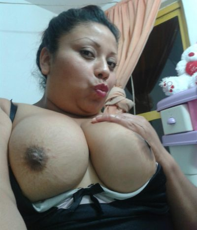 Gorgeous latina milf with big tits shows off on nude selfie. Mexican Milf takes some selfies as she reveals her big jugs and shaved gash