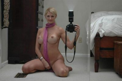 Amateur nude MILF female takes self shots of her big tits on mirror porn picture. Hot sexy babe takes self shots exposing big tits and nude body
