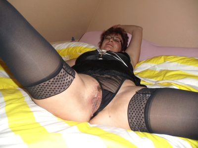 Horny mature babe spreads her legs naked little hairy cunt. Naughty redhead amateur mature woman in glasses shows off her wide open twat after undressing in bed room