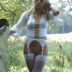 Gorgeous British Milf uncovers her firm cunt as she undresses in backyard. Gorgeous British MILF bares her beautiful pussy outdoors in stockings