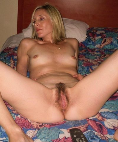 Beautiful MILF wife gets naked in the bedroom to stuff her hairy pussy. Sweet wife bares her small tits as she removes her clothes