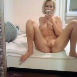 Amateur blonde wife clicks off pussy on selfie as she undresses. Small tit blonde undressing that stunning body and tight pussy