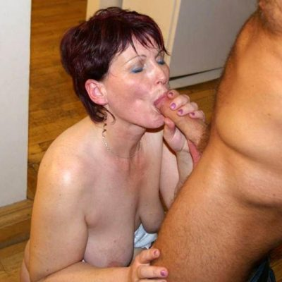 Redhead mature babe holds her knockers while giving a blowjob. Amateur MILF with saggy boobs amazing cock sucking until the last drop