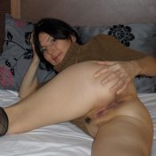 Happy MILF gets naked to show her perfect round ass