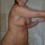 Plump MILF takes a shower
