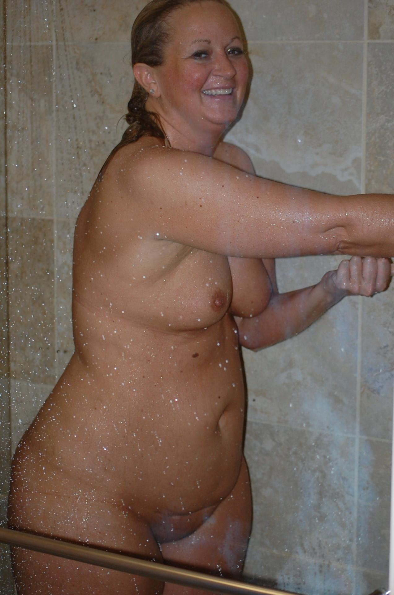 Chubby housewife showering her massive body. Plump MILF whips out her hooters as she strips for a shower