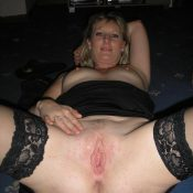 Stocking and lingerie adorned milf blonde exposing pussy