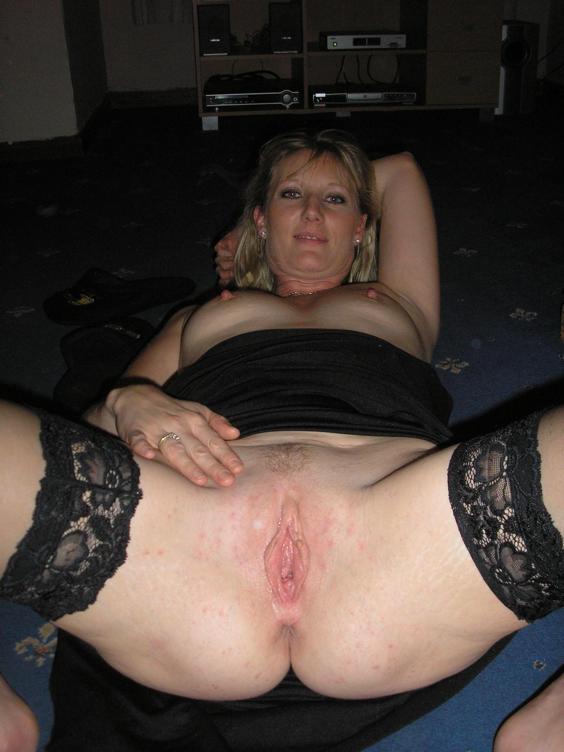 Cute mature showing off pussy and anus up close on pic. Blonde milf in stockings stripping off her lingerie