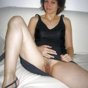 Naughty Milf stripping and showing hot hairy cunt