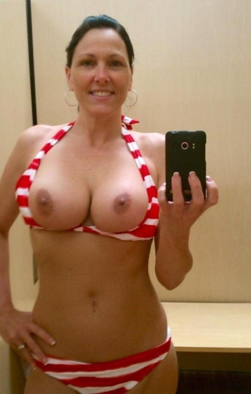 Mature amateur chick takes nude selfie without bra. Busty amateur milf loves taking selfie of attractive nude body