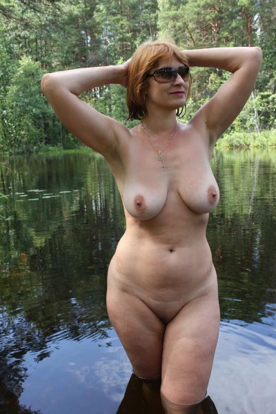 Redhead wife totally nude baring her massive juggs on the lake. Busty amateur MILF has perfect natural body