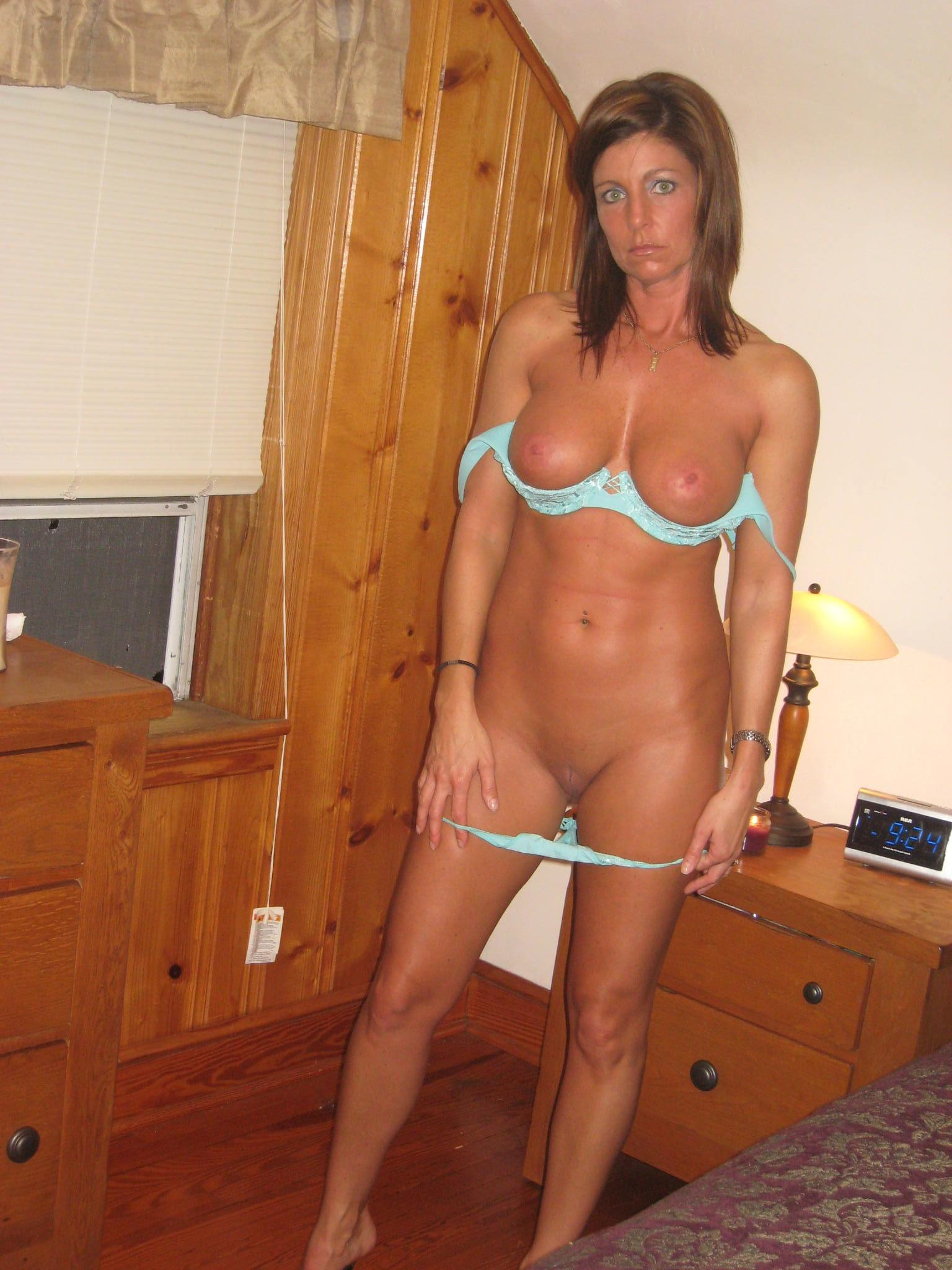 Hot MILF shows off her tight perfect nude body. Brunette amateur teases in blue panties before exposing her boobs