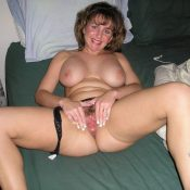 Amateur Mature wife spreads hairy pussy