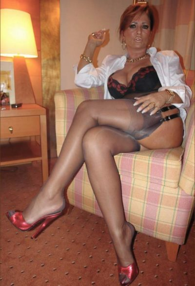 Stunning big boobs wife unveils sweet legs & hot erotic. Hot amateur MILF in lacy black lingerie sitting comfortably in the chair