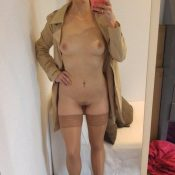 Nude MILF in a coat and stockings