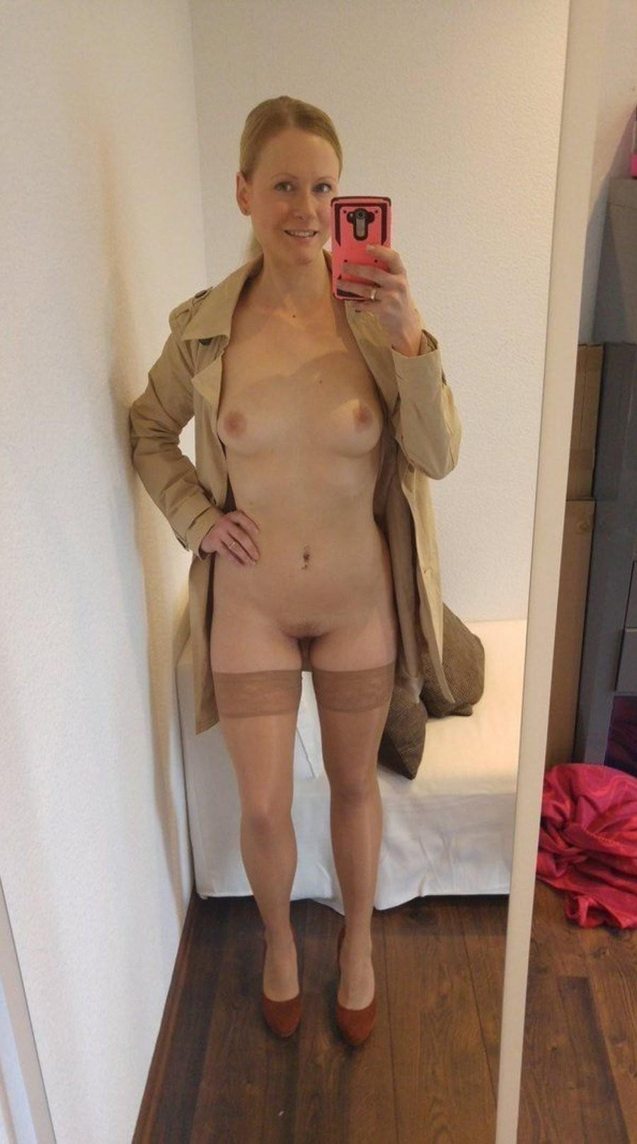 Sexy Nude MILF showing off tits and pussy. Blonde amateur wife takes a self shot in coat & stockings