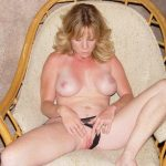 Slender hot wife masturbates her horny pussy wearing a thong. Erotic Amateur MILF stretches pussy close up