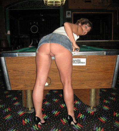 Leggy mommy in high heels bends over at the billiard table flashes naked pussy upskirt. Milf without panties plays billiards
