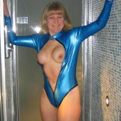 Happy wife releases her great breasts from latex