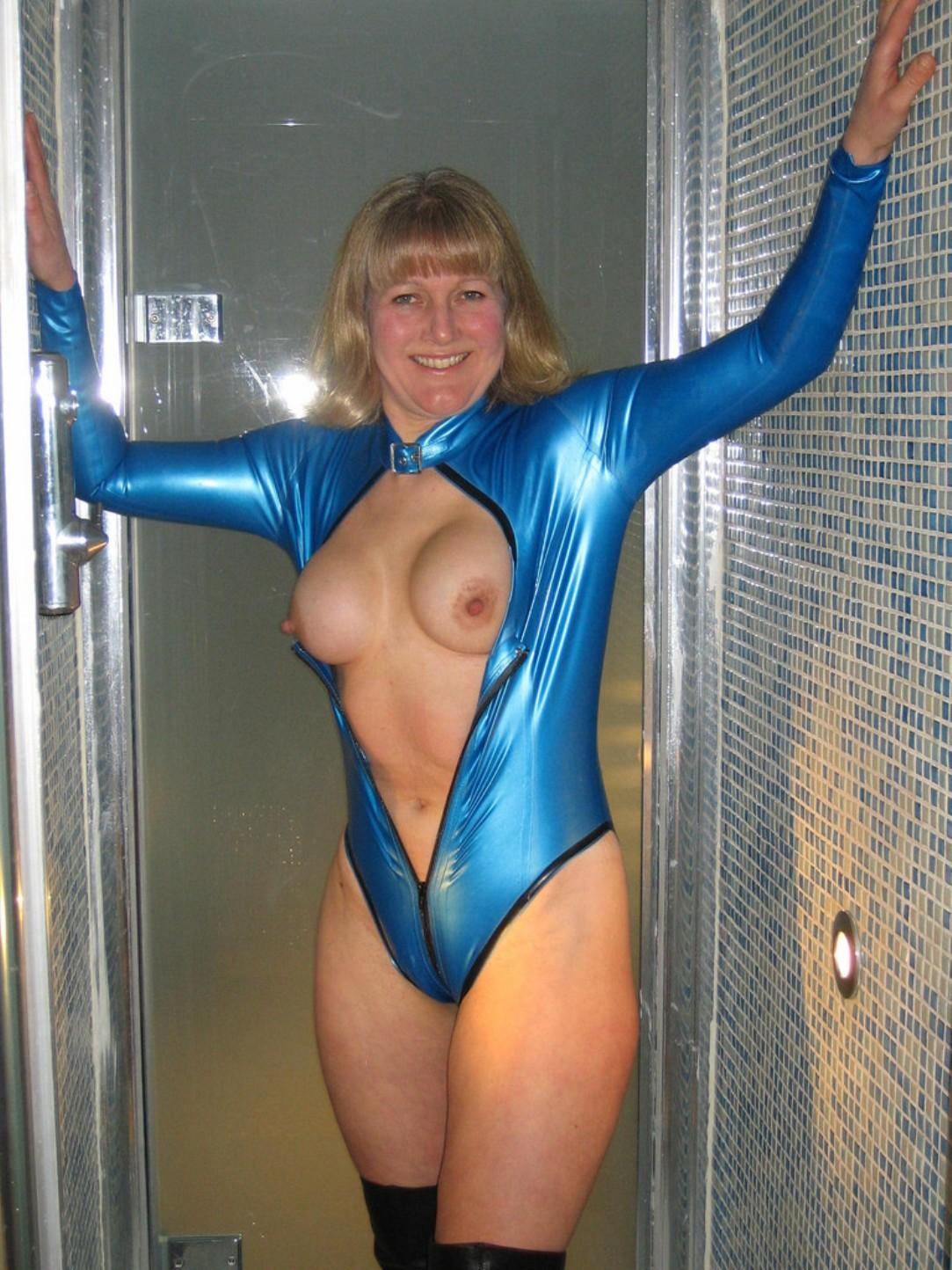 Happy wife with big tits gets dressed in a latex. Blonde babe from the UK shows her big boobs