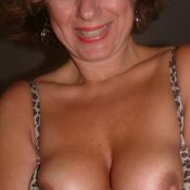 Big titted MILF doesn't have a bra