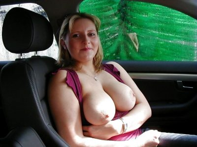 Fat mature amateur takes off her bra for her husband. Busty wife displays her big round tits in a car