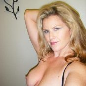 Blonde MILF without a bra takes selfie