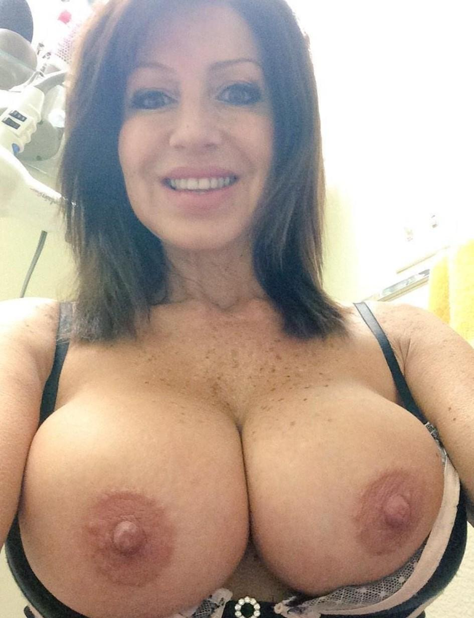 Epic MILF takes nude selfie boobs. Brunette milf strips and flaunts her big tits