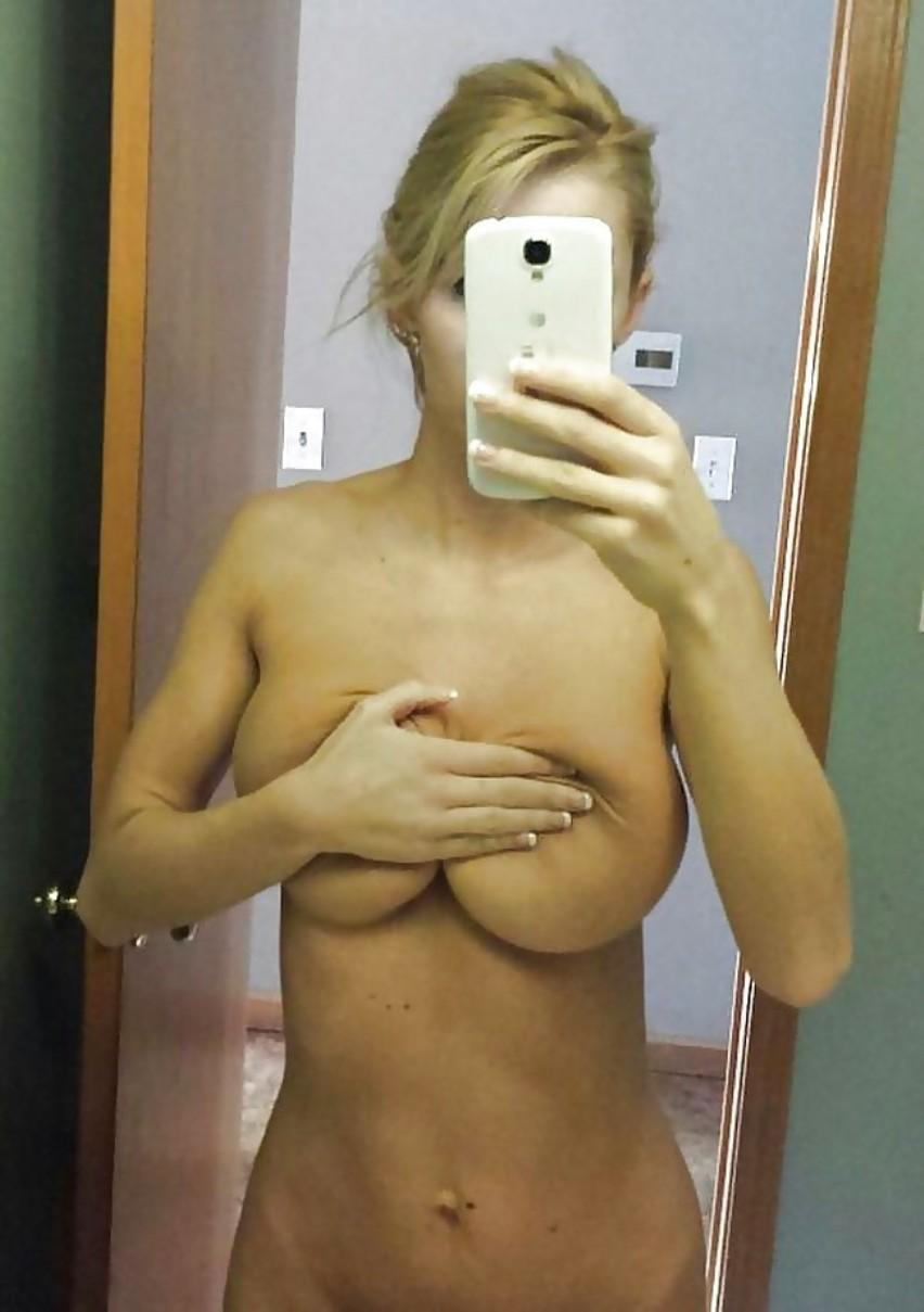 Big Tits MILF loves taking selfie of attractive nude body. Amateur milf showing off her big tits and perfect nipples bathroom selfie in mirror