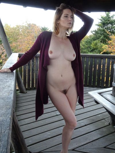 Beautiful European MILF unveils her cute tits before thrusting her naked pussy. Blonde wife works free of sheer clothing before flaunting her bare pussy