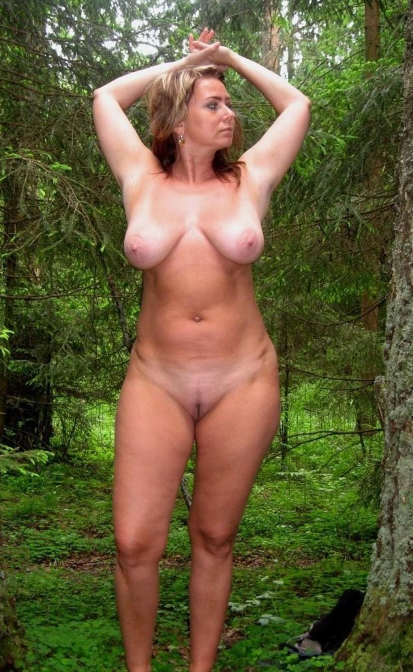 Amateur wife flaunts her huge tits in nature. Sexy MILF with perfect body flashes her hot boobs
