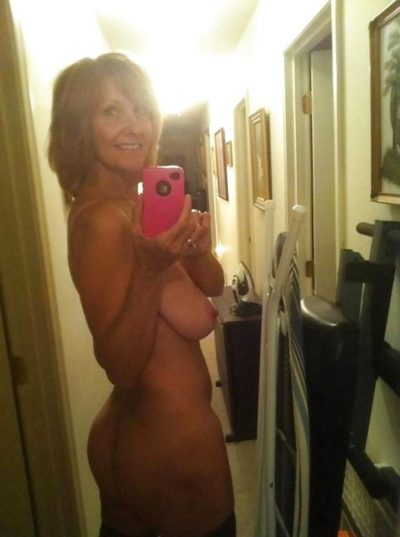 Blonde hot wife removes her lingerie to set her hot ass and saggy tits. MILF takes selfies and strips naked