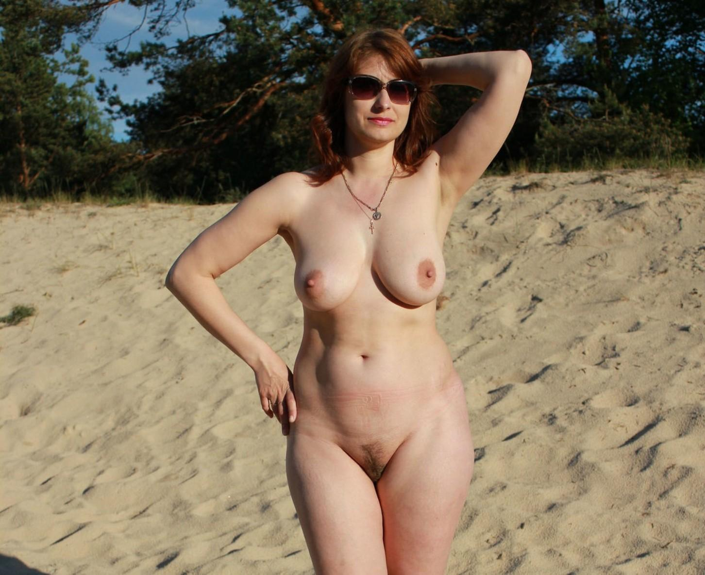 Beautiful mom sheds her bathing suit to go naked on a sandy beach. Redhead mature women baring natural breasts & little hairy pussy at the beach