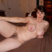 Nude amateur milf displays hairy pussy
