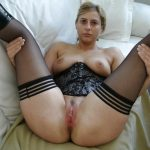 Hot MILF with natural tits surprises us with ring in pussy lips. Cougar shows off her bald slit and bare bum atop bed spread
