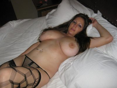 Brunette busty amateur MILF strips and flaunts her big tits. Mature lady posing with her outstanding big tits