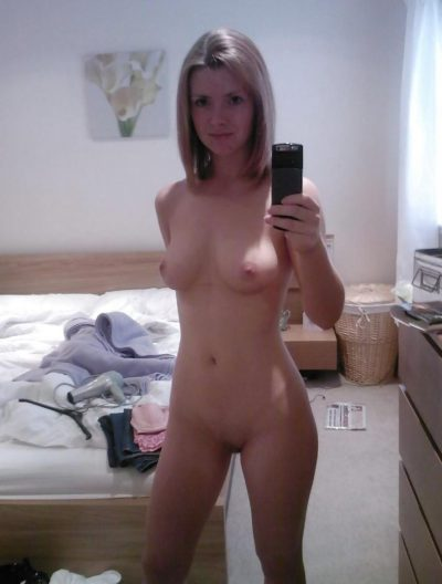 Tiny amateur wife take selfie while she exposes her petite body. Blonde MILF snapping selfie in mirror