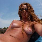 Hot redhead milf takes nude selfie