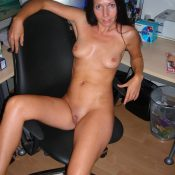 Sexy skinny MILF is sitting on the armchair