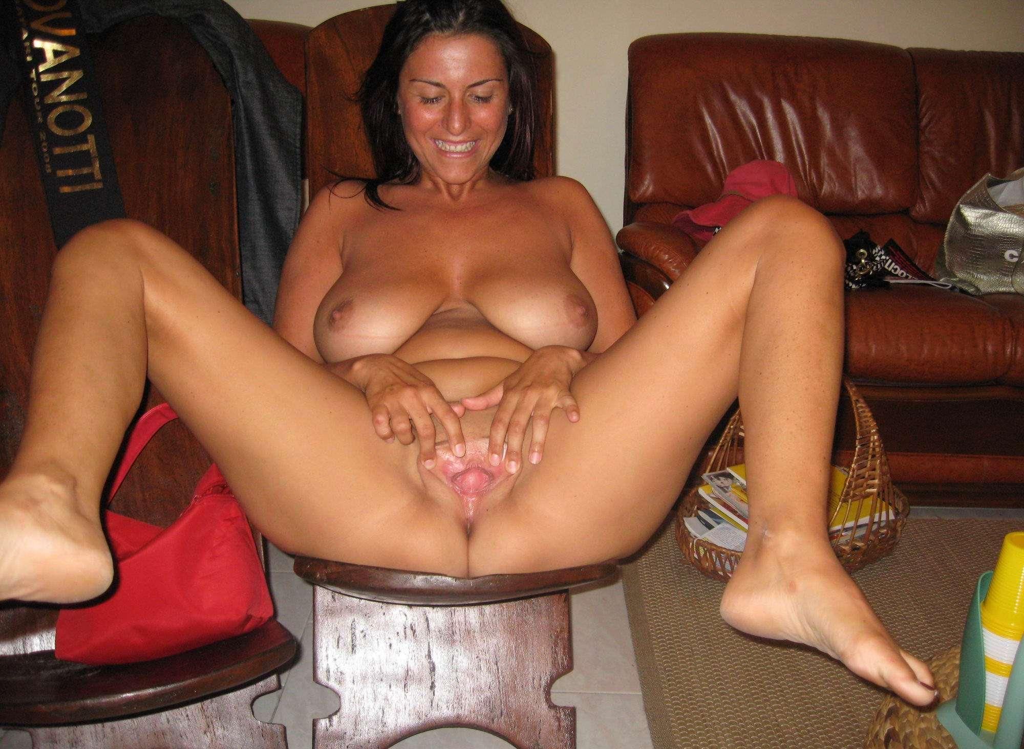 Busty MILF does an incredible striptease performance. Woman with firm boobs and meaty pussy lips tries nude spreading
