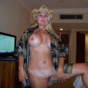 Big-boobied MILF takes off sexy bra and panties